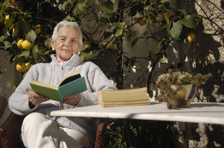only senior women: old woman reading a book
