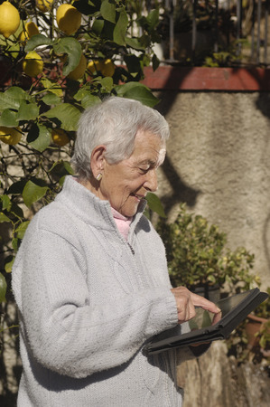 only senior women: old woman with tablet