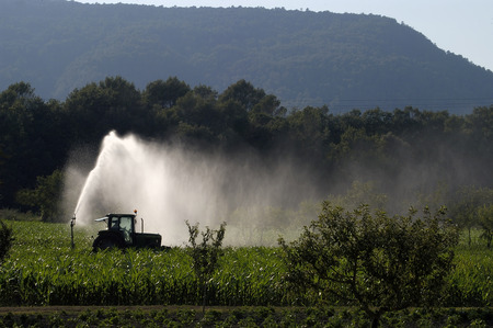 pressurized: tractor watering the field