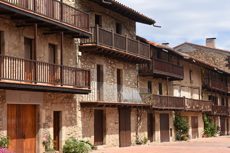 els: Balconies of the picturesque village of Els Hostalets, Garrotxa, Girona province, Catalonia, Spain