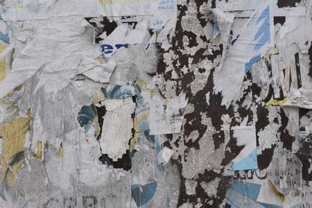 torn paper on a wall Reklamní fotografie