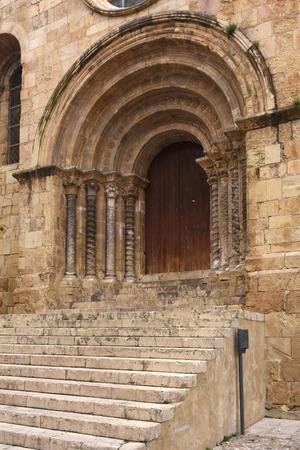 romanesque: Gateway romanesque church of Santiago, XII-XIII centuries. Coimbra, Portugal Stock Photo