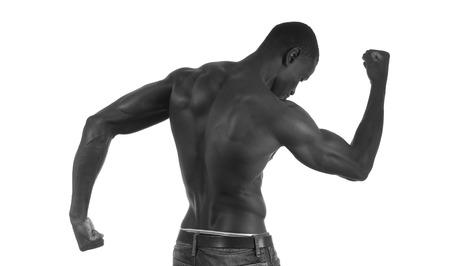 naked african: back of a naked African man, white background