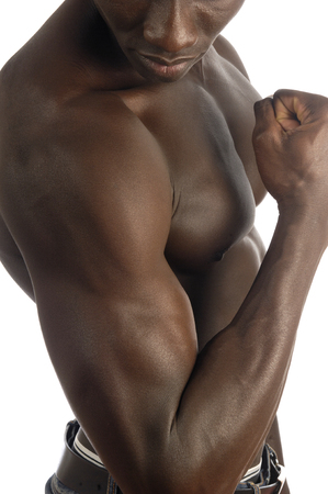 tearing down: biceps of an African man with white background