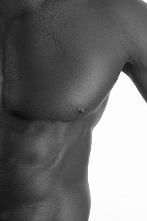 pectoral: pectoral muscle of a black man with a muscular body, white background. Stock Photo