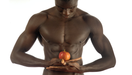 nipple man: African man with an apple on white