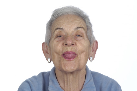 sticking to: old woman sticking out her tongue Stock Photo