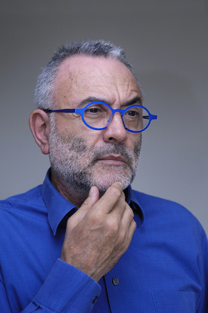 the ageing process: middle-aged man with blue shirt and glasses Stock Photo