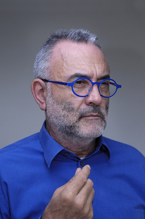 middle-aged man with blue shirt and glasses Stock Photo