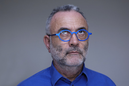 only senior men: middle-aged man with blue shirt and glasses Stock Photo