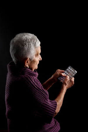 blister: Senior woman with blister medications