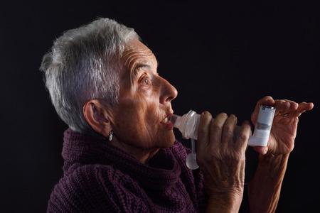 Senior woman with inhaler