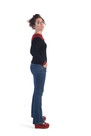 expressive face: Woman with blue jeans and a white background