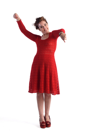 Full portrait dancing woman in red