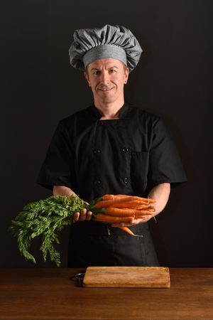 camra: chef chopping a carrot