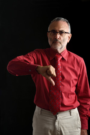 Man with thumb down