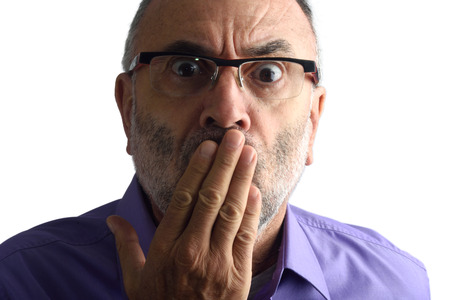 55 years old: Man with hand in mouth
