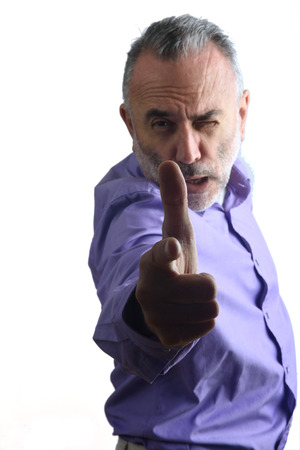 age 60: A man pointing with a gun that is the finger
