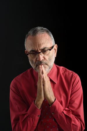age 60: Praying man