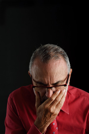 60 65 years: distressed man Stock Photo