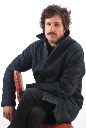 Portrait of a man sitting on a chair Stock Photo