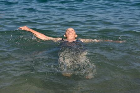 backstroke: Senior woman enjoying of backstroke Stock Photo