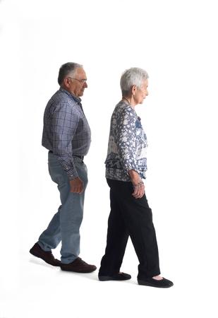 75 80: Full portrait couple walking on a white background