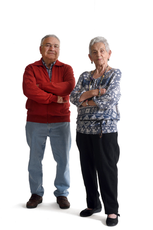 70 75: Senior couple with arms crossed on white
