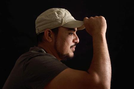 Portrait of a latin man on black background Stock Photo