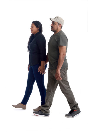 latinamerican couple walking on white Stock Photo