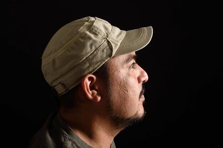 look latino: Portrait of a latin man on black background Stock Photo