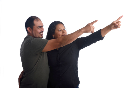 latinamerican: latinamerican couple point in white Stock Photo