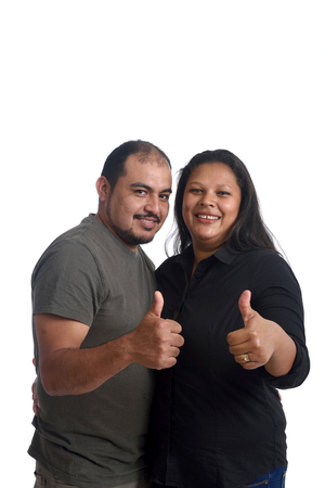 latinamerican: Couple doing the sign thumbs up on white background