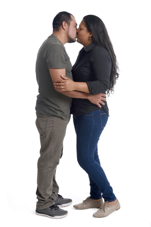 creole: Couple giving a kiss on white background Stock Photo