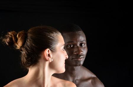 adult sex: Portrait of a couple on black background
