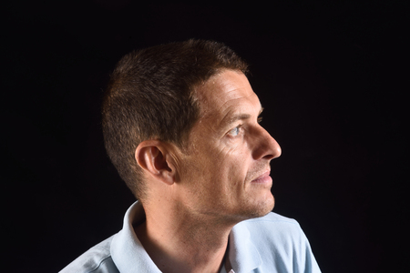 portrai of a man with black background
