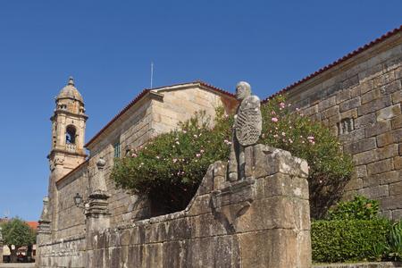 Balboa sculpture custodian and San Benito church, Cambados, Pontevedra province, Galicia, Spain Stock Photo