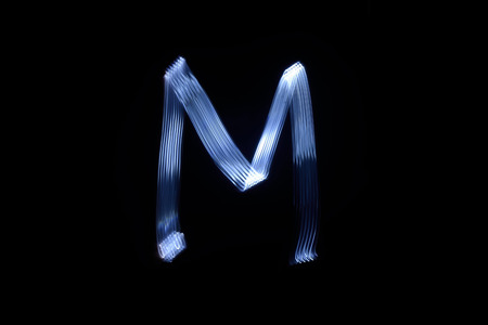 paint with light on black background letter M Stock Photo - 89447309