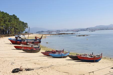 Arousa Island boats on the beach Praia Cabodeiro, Pontevedra province, Galicia, Spain