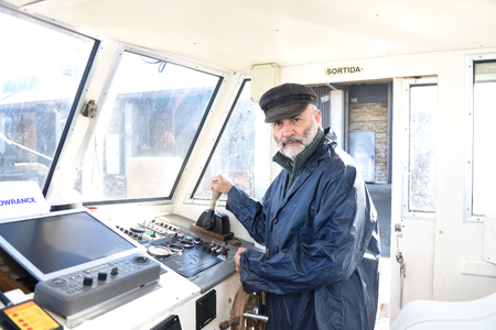 driving a fishing boat Stock Photo