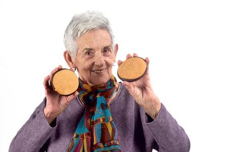 senior woman eating cookie  on white background