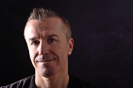 portrait of a man on black background