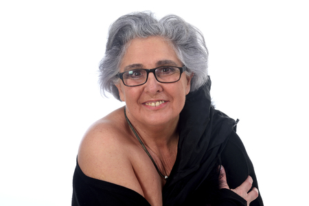 an older woman with a sexy posed on white background Stock Photo