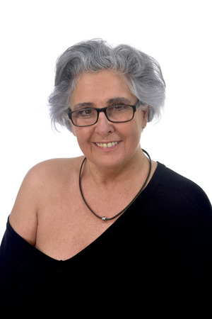 an older woman with a sexy posed on white background Imagens