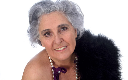 an older woman with a sexy posed on white background Foto de archivo