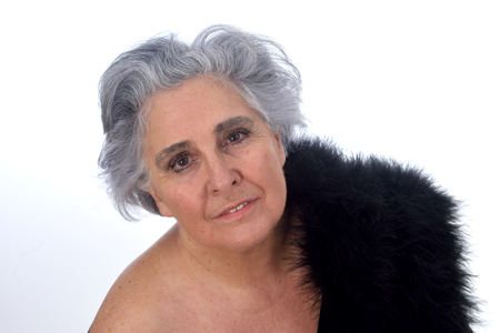 an older woman with a sexy posed on white background Standard-Bild