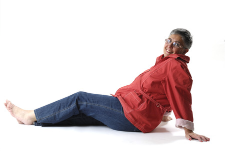 senior woman sitting on white background