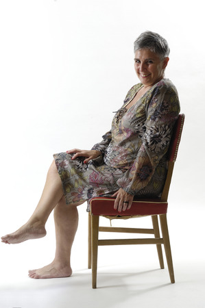 portrait of a senior woman sitting with short