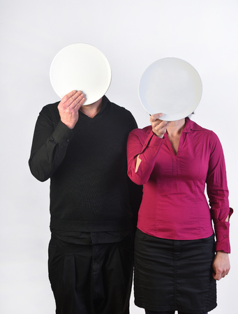 a couple with dishes in the face