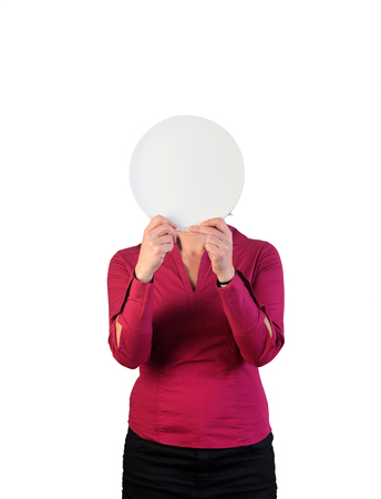 a woman holding an empty plate in front of her face